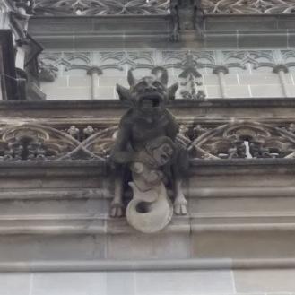 Gargoyle choking a mermaid, Muensterkirche,